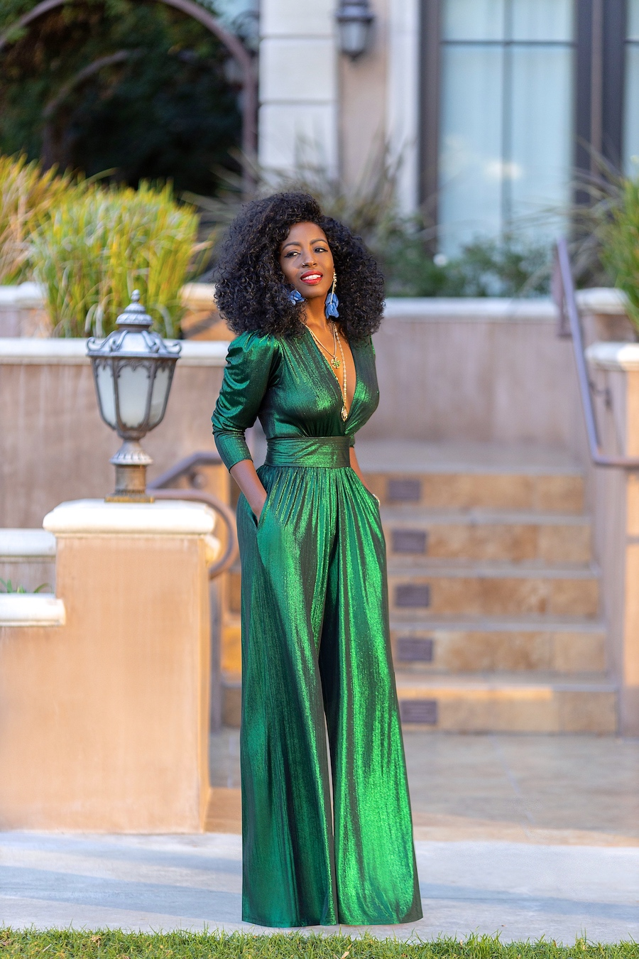 Side angle of the emerald green jumpsuit from FKSP